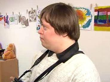 Mladík postižený Downovým syndromem