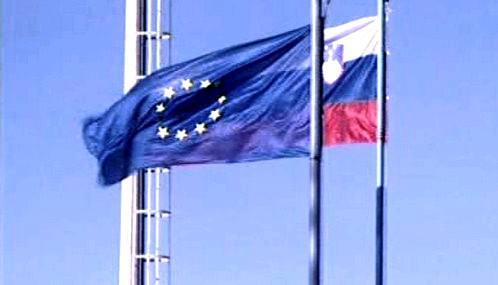 Vlajky EU a Slovinska