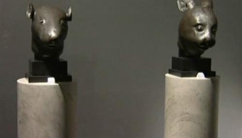 Bronzové hlavy zajíce a krysy