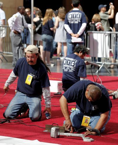 Červený koberec k Oscarům patří