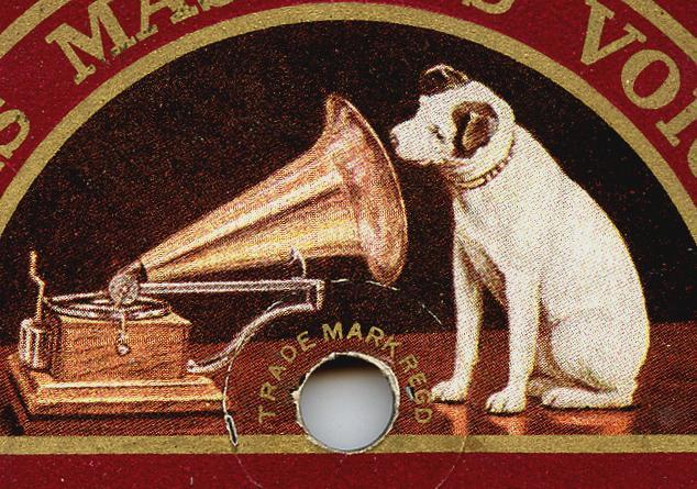 Pes poslouchá gramofon