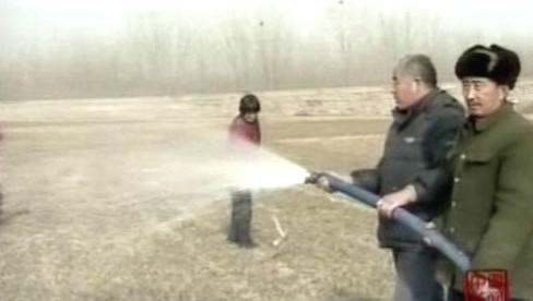 Čínští farmáři zavlažují