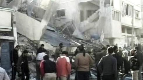 Poničené domy v pásmu Gazy