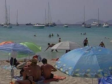 Lidé na španělské pláži