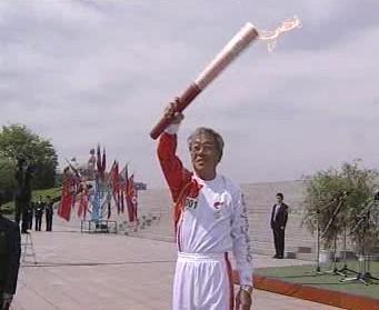 Olympijská pochodeň v Pchjongjangu