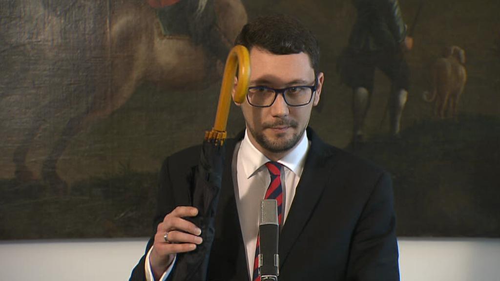 Ovčáček ukazuje Chamberlainův deštník pro Zaorálka