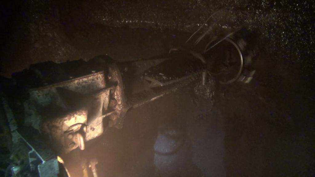 Vrták, který těží uhlí v chodbici
