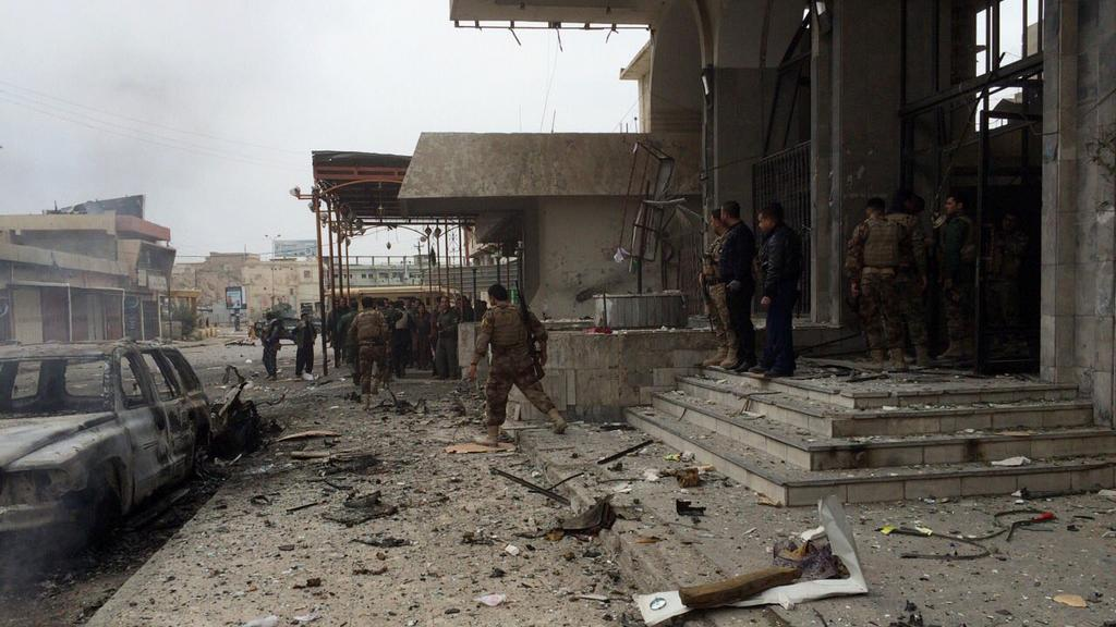Kurdští pešmergové v boji o Kirkúk