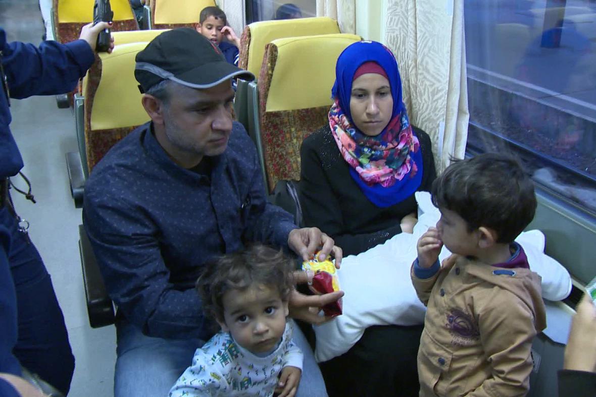 Uprchlíci ve vlaku do Německa