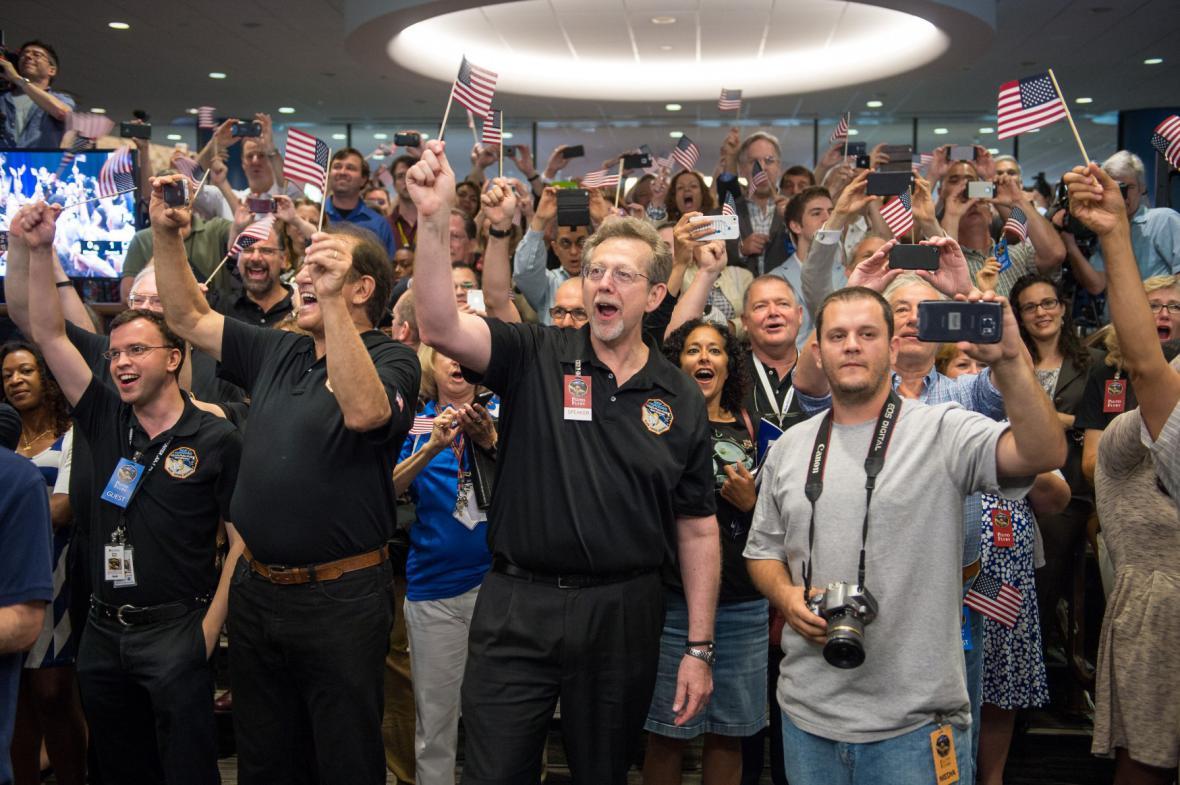 Mise Pluto: radost v týmu NASA