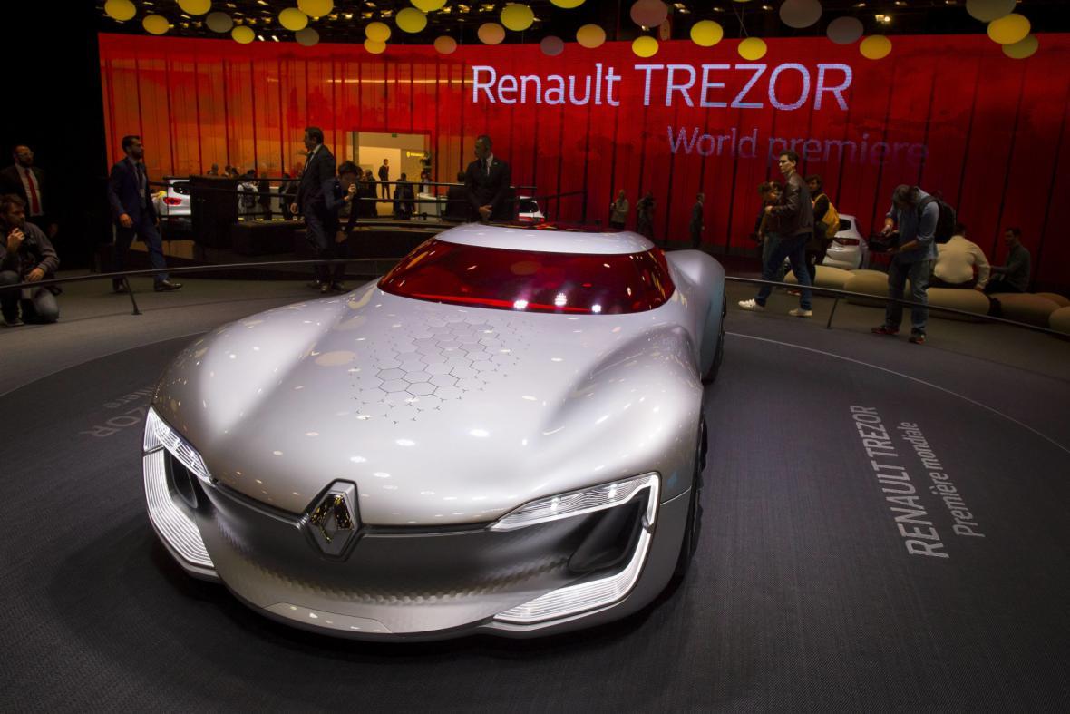 """Sportovní vůz kosmických tvarů Renault TreZor (francouzsky poklad) jezdí čistě na elektřinu díky 260kW motoru a z 0 na 100 km/h zrychlí pod čtyři sekundy. Unikátní je i způsob otevírání a nastupování. Renault TreZor má totiž jediné """"dveře""""."""