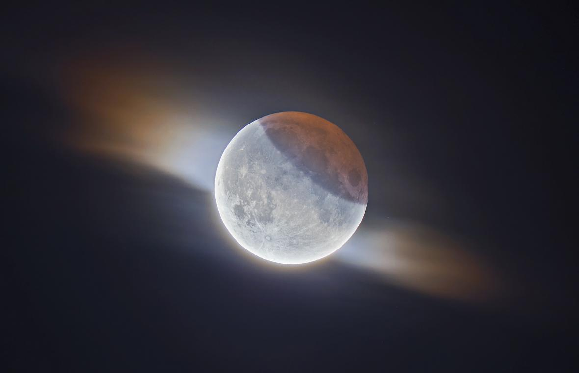 Partial Lunar Eclipse With Clouds © Ethan Roberts