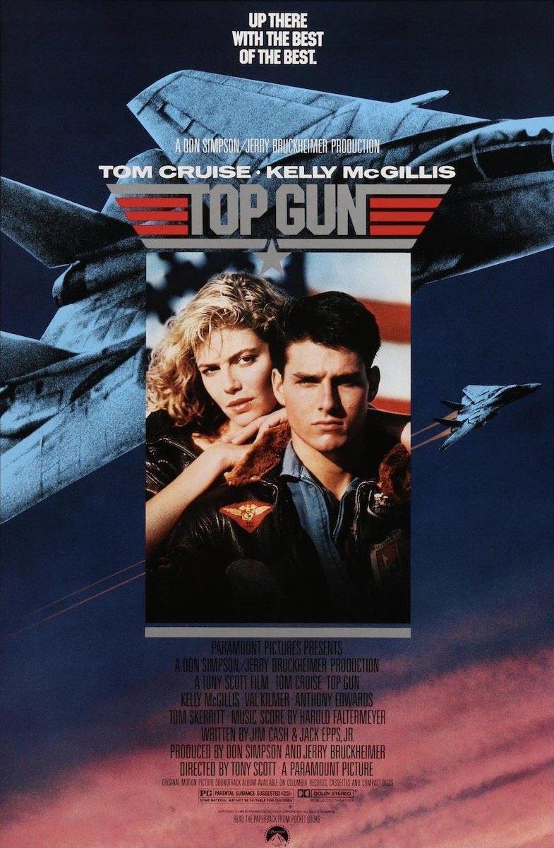 Jeden z originálních plakátů hollywoodského trháku Top Gun, který proslavil palubní stíhač F-14 po celém světě; v současné době se připravuje uvedení jeho pokračování, v něm už však F-14 hrají pouze nostalgickou roli, hlavní hrdinové létají v F/A-18