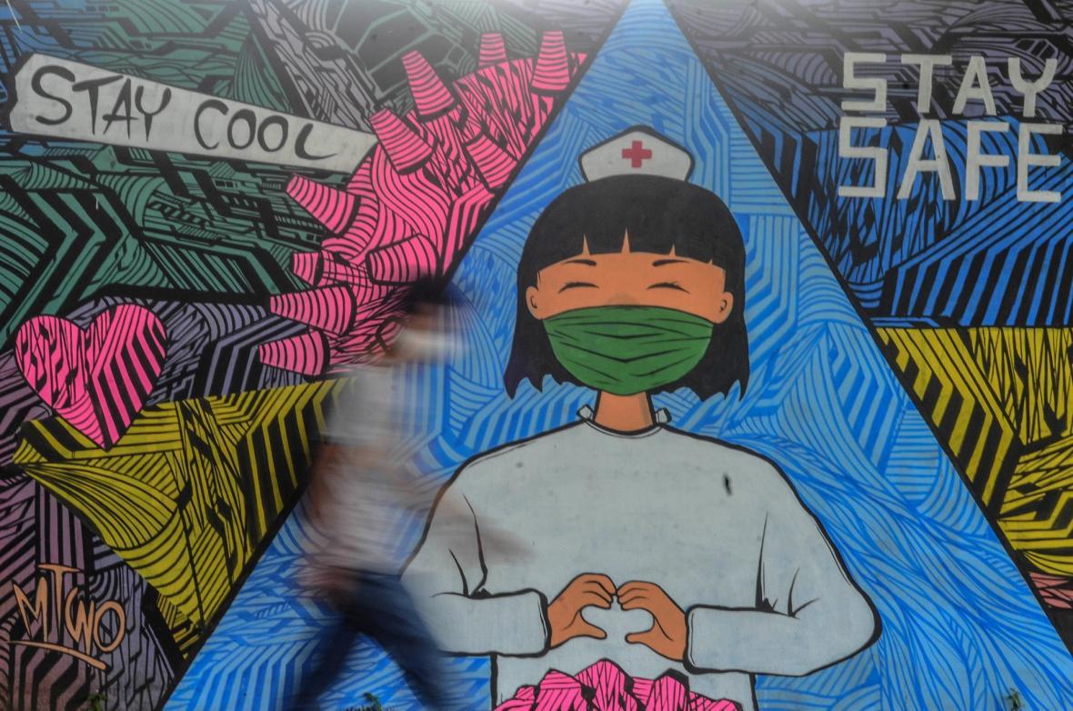 Coviden inspirované graffiti tvoří neznámý umělci po celém světě