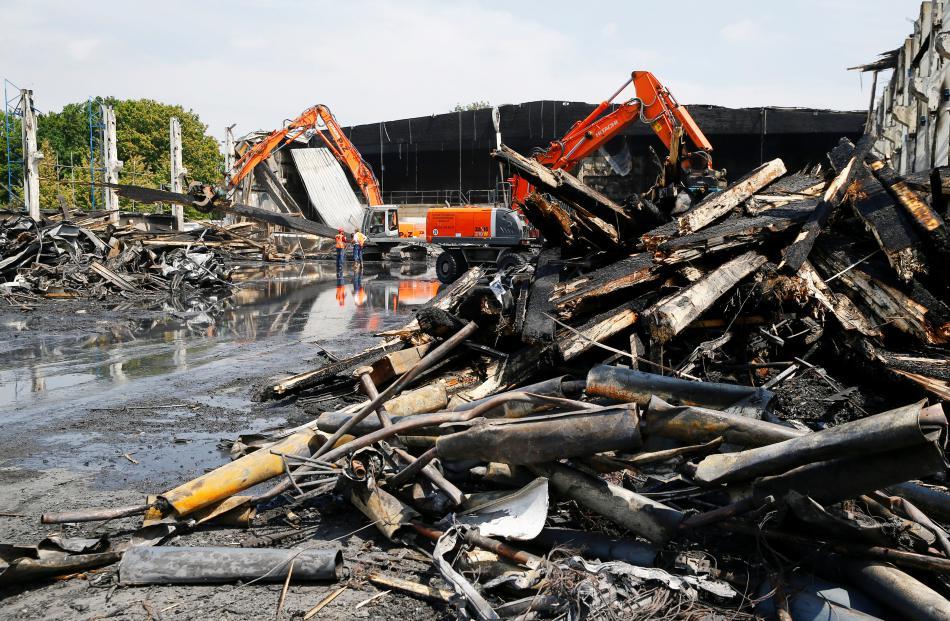 Likvidace vyhořelé ubytovny v Düsseldorfu