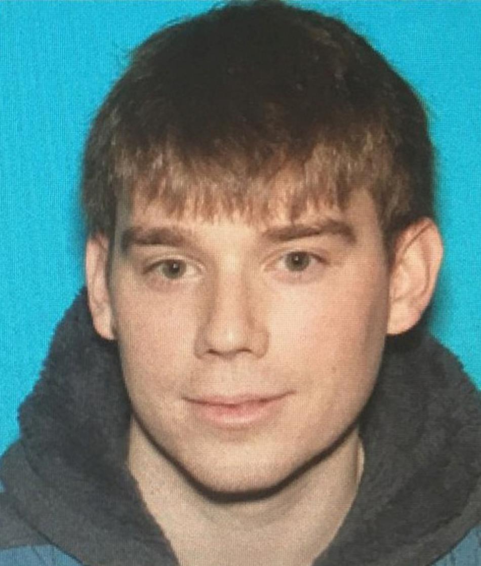 Podezřelý Travis Reinking